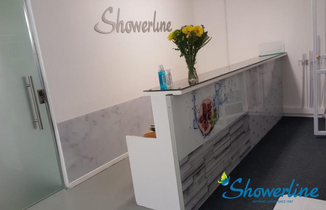 Showerline reception area with glass splashback